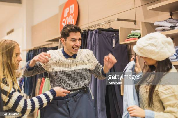 Young man shopping with friends