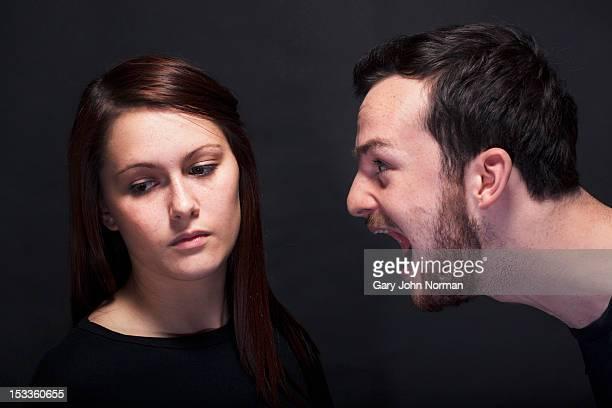 young man shouting at young woman headshots