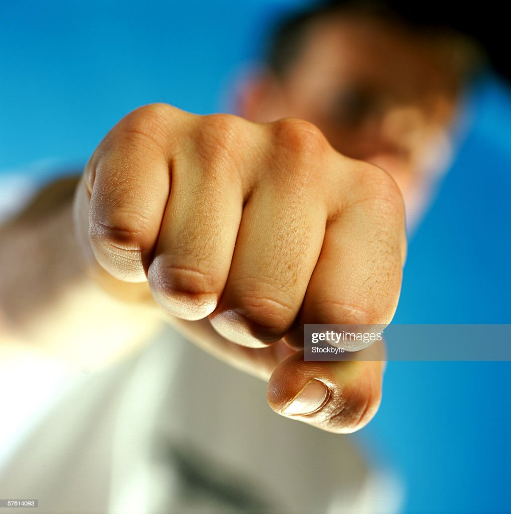 Young man showing his fist : Stock Photo
