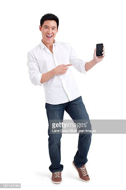 young man showing mobile phone - 襟付きシャツ ストックフォトと画像