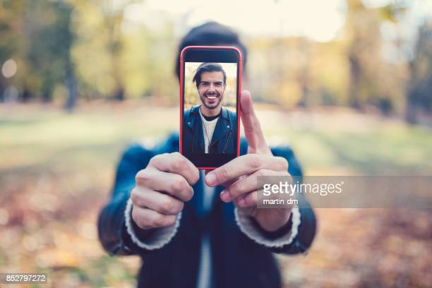 Young man showing selfie to the camera