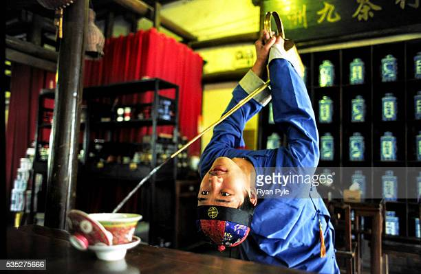A young man shows off his tea pouring skills at a Tai Ji Tea House in Hangzhou China In China tea is much more than just a warm beverage it is an...