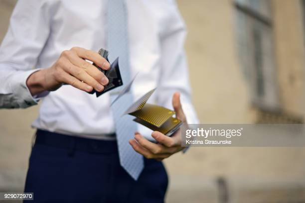 young man shuffling cards - shuffling stock photos and pictures