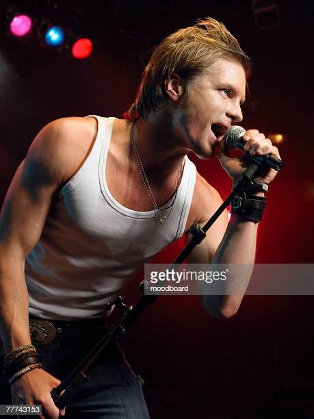 Young Man Singing at Concert