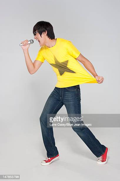 Young Man Singing Passionately