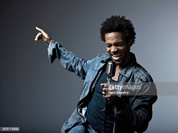 young man singing - singer stock pictures, royalty-free photos & images