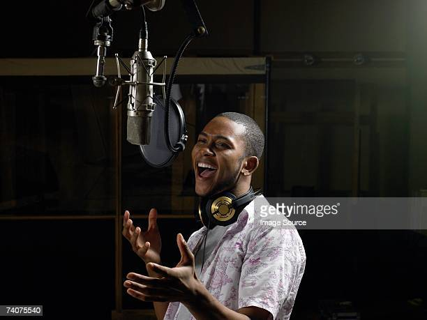 young man singing - sound recording equipment stock pictures, royalty-free photos & images