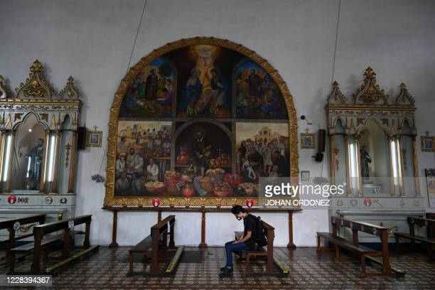 Young man sits on a pew at the San Francisco church in Antigua Guatemala, Sacatepequez Departament, 45 km southeast of Guatemala City on September 6,...