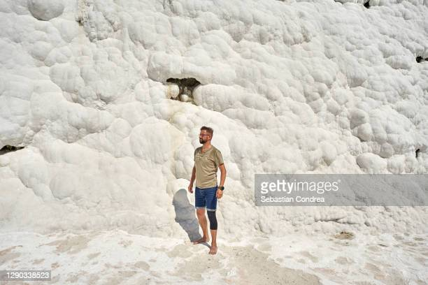 young man sitting at the natural travertine pools and terraces in pamukkale, denizli - royal tour stock pictures, royalty-free photos & images