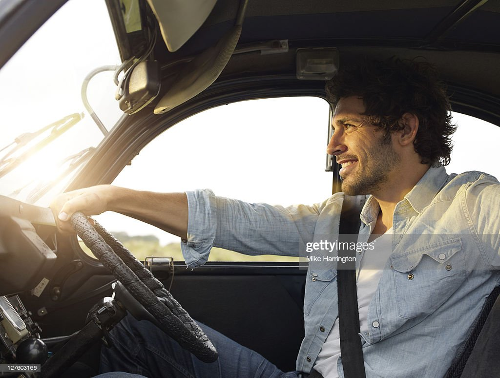 Young man sitting in car : Stock Photo