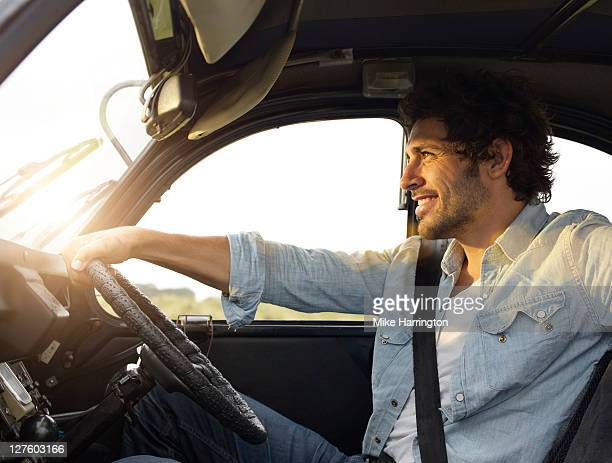 Young man sitting in car