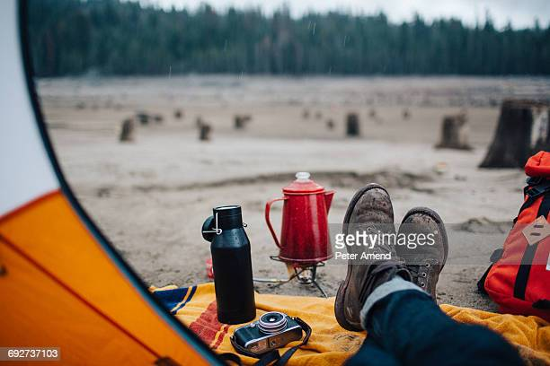 young man sitting in tent on beach, huntington lake, california, usa - open backpack stock pictures, royalty-free photos & images