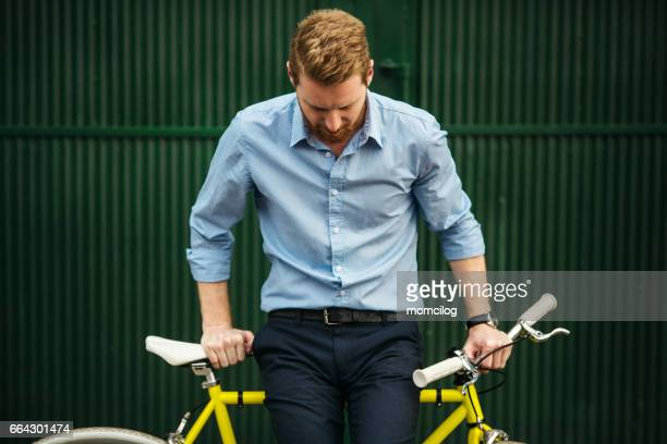 Young man sitting on a bike