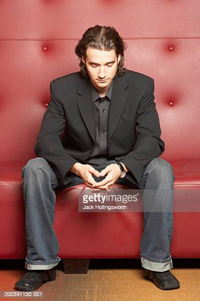 Young man sitting on a couch