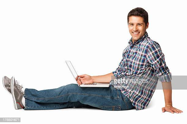 young man sitting on floor with a laptop - isolated - checked shirt stock photos and pictures