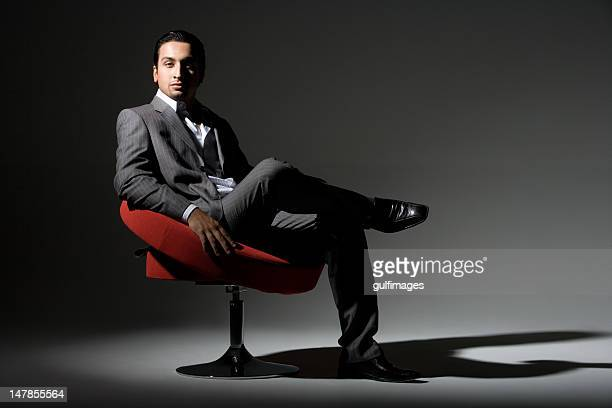 Young man sitting on swivel chair, portrait