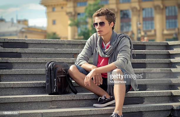 Young man sitting on the stairs
