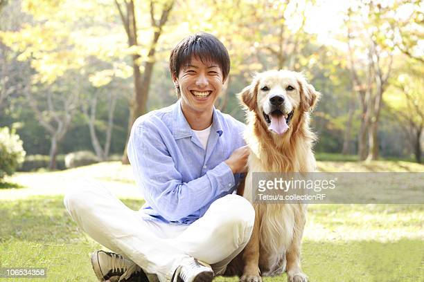 Young Man Sitting with Dog