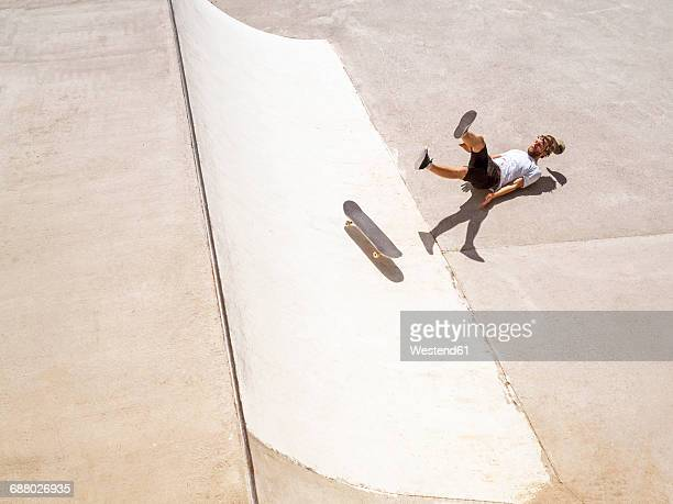 Young man skate boarding in skate park