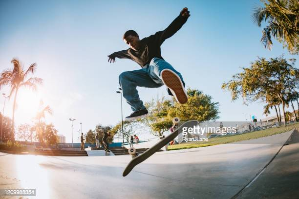 young man skateboarding in los angeles - skating stock pictures, royalty-free photos & images