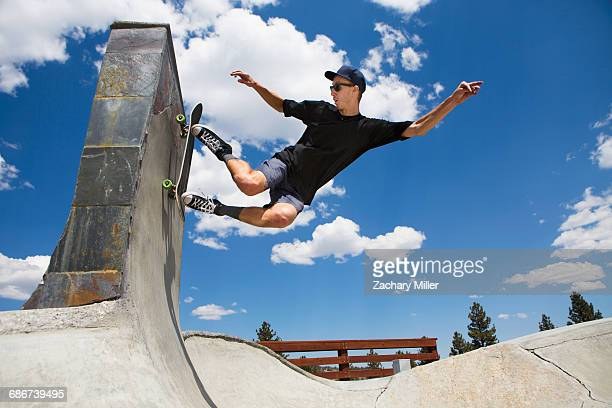 """""""young man skateboarding in skate park ramp, mammoth lakes, california, usa"""" - smooth stock pictures, royalty-free photos & images"""