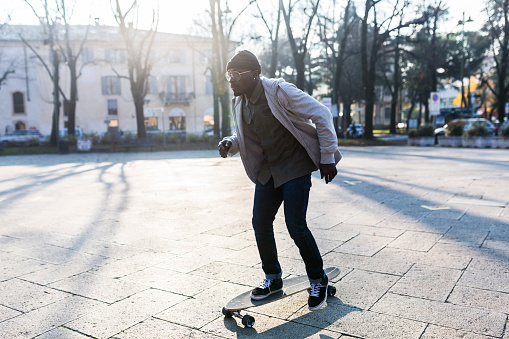 Young man skateboarding on an urban squarre - gettyimageskorea
