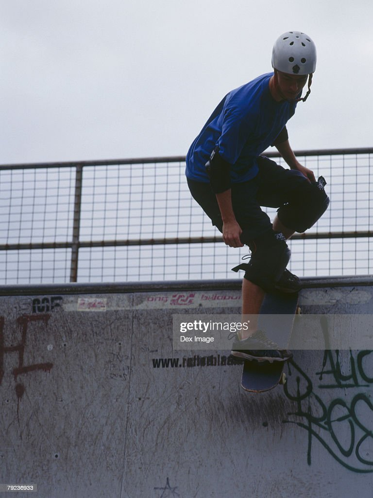 Young man skateboarding on ramp : Stock Photo