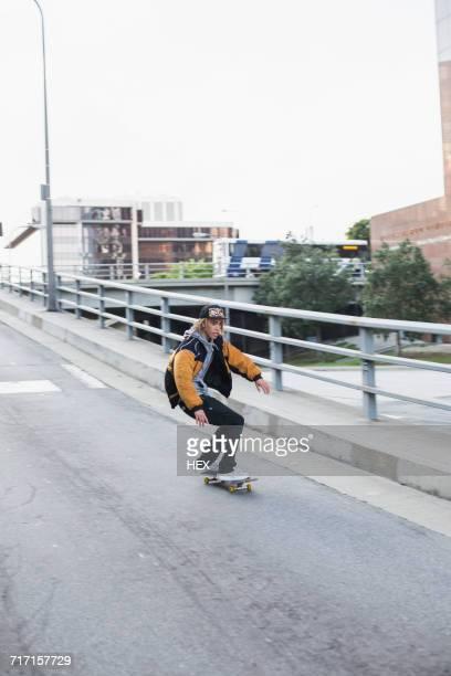 young man skateboarding. - rasta photos et images de collection