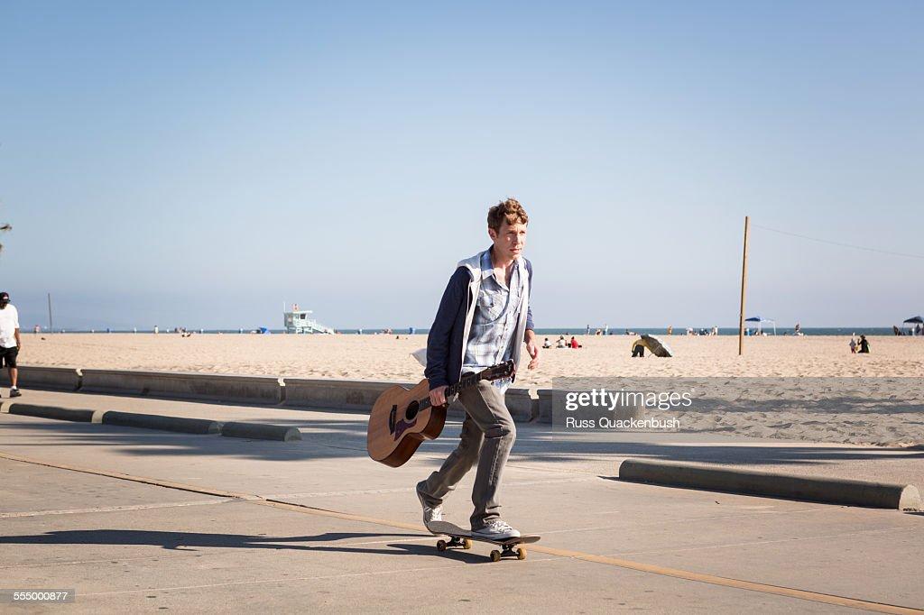 Young man skateboarding, Santa Monica Pier, Santa Monica Beach, US : Stock Photo