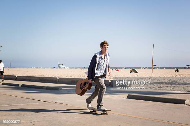 Young man skateboarding, Santa Monica Pier, Santa Monica Beach, US