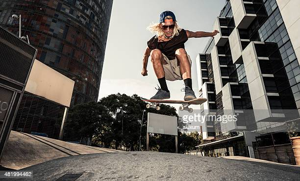 young man skating in barcelona spain - ollie pictures stock pictures, royalty-free photos & images