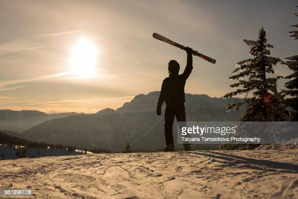 Young man, skiing on sunset in Austrian Alps, winter scenery sunset landscape