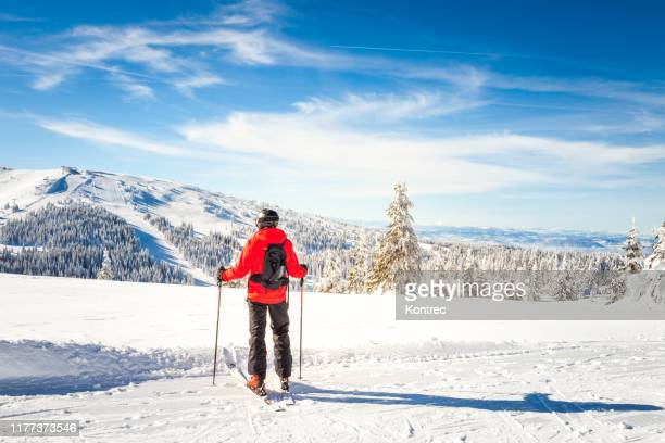 young man skiing - ski holiday stock pictures, royalty-free photos & images