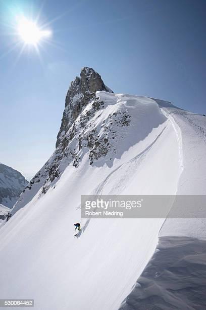 young man skiing, tyrol, austria - schneebedeckt stock-fotos und bilder