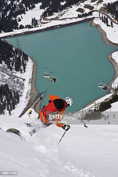 a young man skis fresh powder off-piste at the kuhtai ski resort near innsbruck, austria. - インスブルック ストックフォトと画像