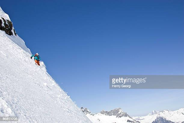 a young man skis untracked powder off-piste at st. anton am arlberg, austria. - steep stock photos and pictures