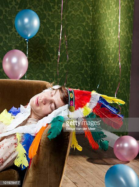 young man sleeping on sofa after party. - hangover after party stock pictures, royalty-free photos & images