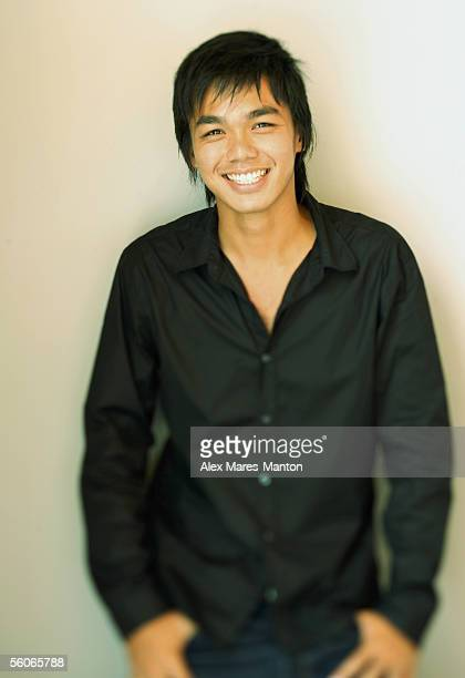 young man smiling at camera, portrait - waist up stock pictures, royalty-free photos & images