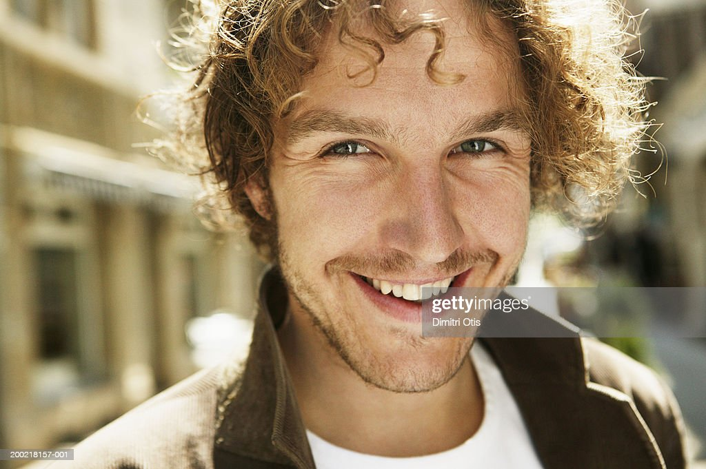 Young man smiling, close-up, portrait : Stock Photo