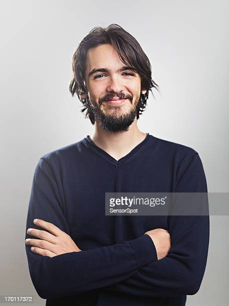 young man smiling - waist up stock pictures, royalty-free photos & images