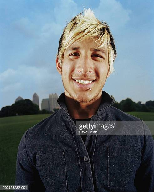 young man smiling, portrait - bleached hair stock photos and pictures