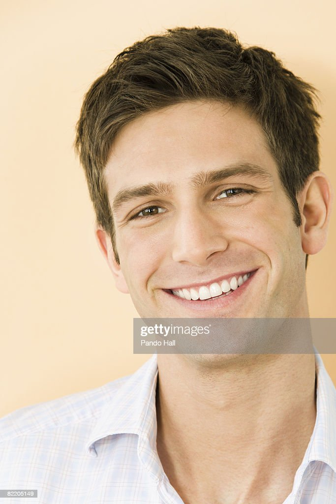 Young man smiling, portrait : Stock Photo