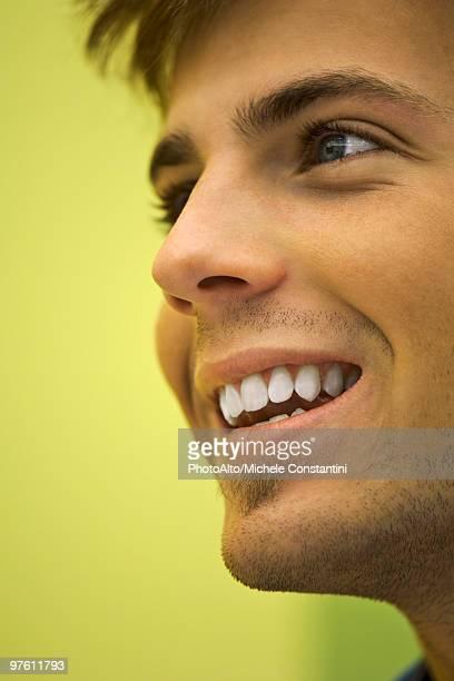Young man smiling, portrait