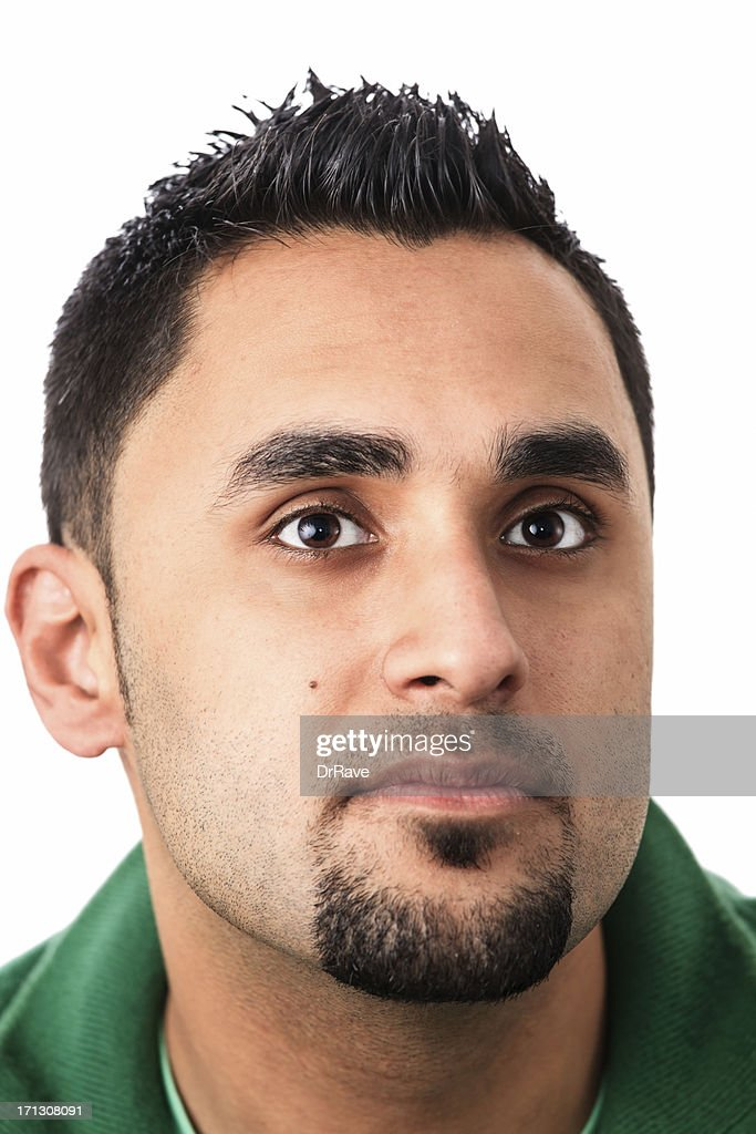 Young man smiling slightly : Stock Photo
