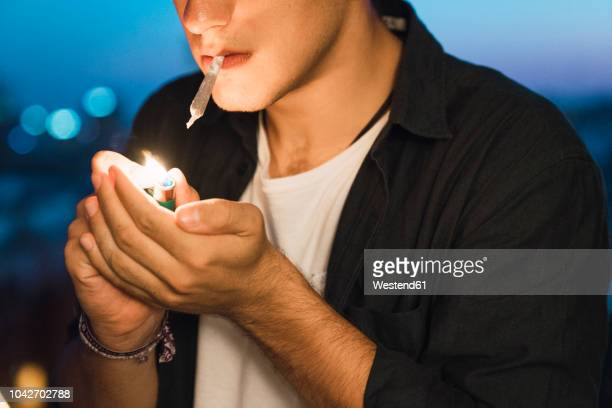 young man smoking a joint - hashish stock pictures, royalty-free photos & images