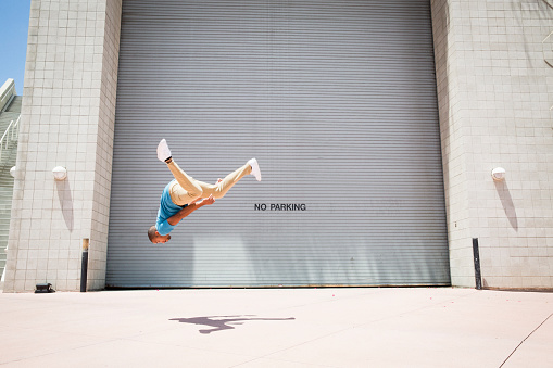 Young man somersaulting, a parcour runner, - gettyimageskorea