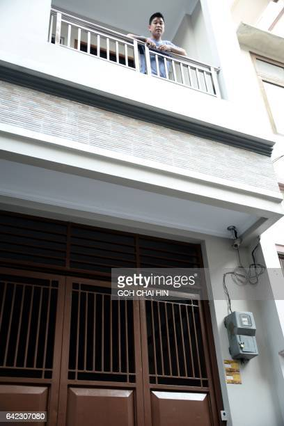 A young man speaks from the balcony of the Jakarta home of Tjia Liang Liong the former fatherinlaw of 25yearold Indonesian Siti Aishah who was...
