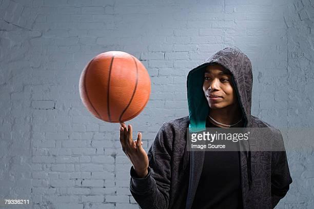 Young man spinning basketball