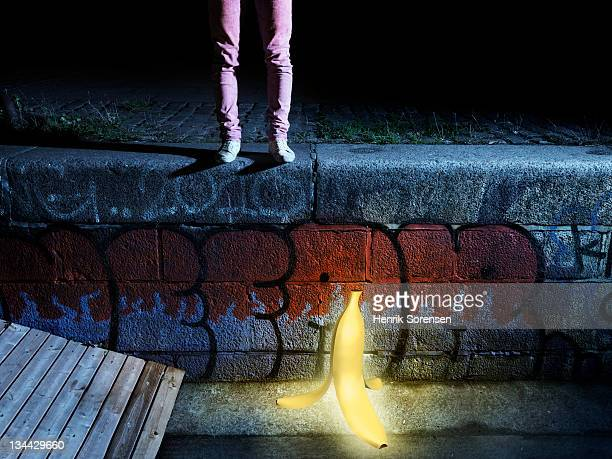young man standing above glowing banana