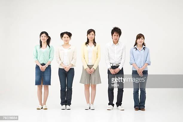 Young man standing among four women